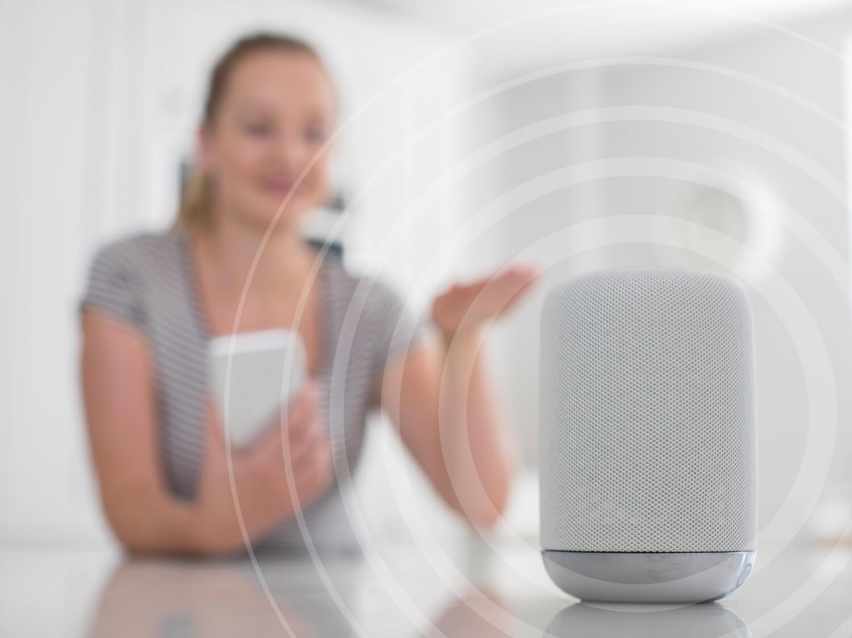 Woman speaking into smart speaker