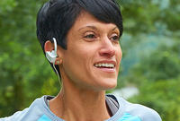 Woman with Earbuds Running